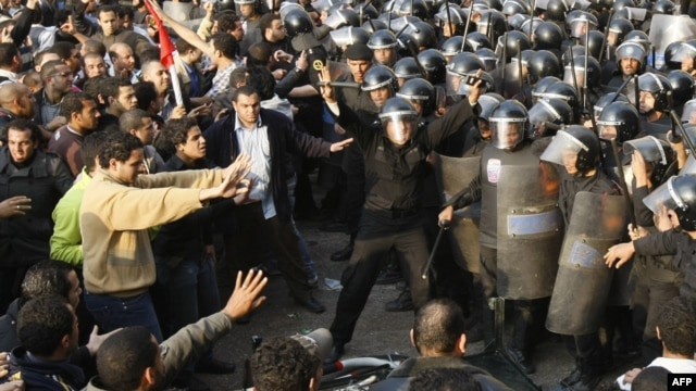 Demonstrators clash with police in central Cairo on January 25.