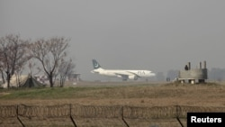 A plane prepares to take off at the Benazir Bhutto airport near Islamabad.