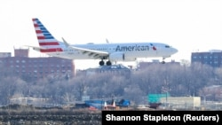 An American Airlines Boeing 737 Max 8, on a flight from Miami to New York City, comes in for landing at LaGuardia Airport in New York, March 12, 2019