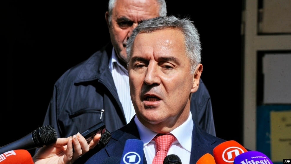 "Montenegrin Prime Minister Milo Djukanovic speaks to journalists after voting during parliamentary elections at a polling station in Podgorica. ""Montenegro is continuing towards its European future,"" he says."
