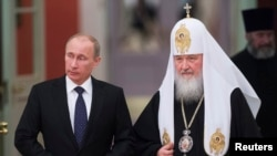 "Patriarch Kirill (right) is a close ally of Russian President Vladimir Putin, whose rule he once famously likened to ""a miracle of God."""