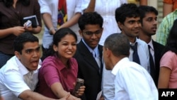 U.S. President Barack Obama shakes hands with students at St. Xavier College in Mumbai today.