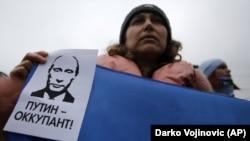 Під час мітингу проти окупації Росією українського Криму. Сімферополь, 11 березня 2014 року