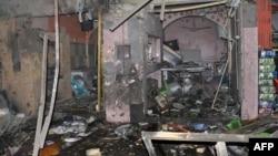 Последствия взрыва в южной части Багдада. 10 августа 2013 года.