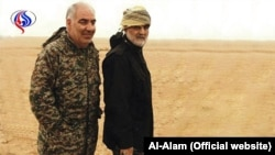Iranian IRGC member Kheirollah Samadi next to Commander of IRGC Qods force Ghasem Soleimani. Undated Photo published by Al-Alam network.