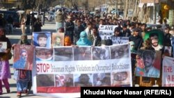Family members of missing Baluchs, mostly political activists, rally in protest on the eve of international Human Rights Day in Quetta, Balochistan, on December 10, 2011.