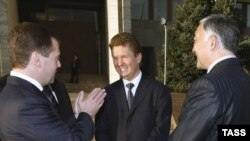 Russian President Dmitry Medvedev (left) and Gazprom's Aleksei Miller (center) seal the deal in Bishkek.