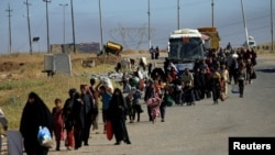 Displaced Iraqis flee their homes during a battle between Iraqi forces and Islamic State militants in western Mosul last month.