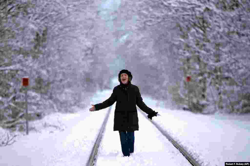 A woman enjoys the snow-covered landscape following a blizzard near New York City on March 24. (AP/Robert F. Bukaty)