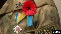 Generic – A remembrance poppy and Ukrainian soldier