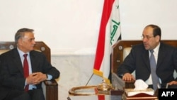 Iraqi Prime Minister Nuri al-Maliki (right) meets with Yunadim Kanna, a Christian member of parliament, last month.