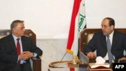 Iraqi Prime Minister Nuri al-Maliki (right) meets with Yunadim Kanna, a Christian member of parliament, last month.