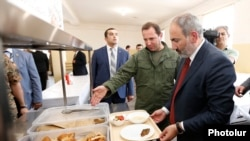Armenia -- Prime Minister Nikol Pashinian and Defense Minister Davit Tonoyan (second from right) inspect the new canteen of a military base in Armavir, July 19, 2019.