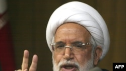 Hossein Karrubi says his father, opposition presidential candidate Mehdi Karrubi (above), talked to parliament about his allegations that opposition protesters have been raped in detention.