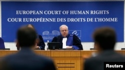 Luxembourg's Dean Spielmann, President of the European court of Human Rights, pronounces a judgment in the case of Dogu Perincek, Chairman of the Turkish Workers' Party, during an hearing at the ECtHR in Strasbourg, France, Oct. 15, 2015.