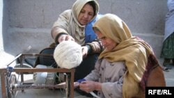 Afghan women begin weaving a carpet in Kabul. Some entrepreneurs have built on traditionally female trades to develop thriving businesses.