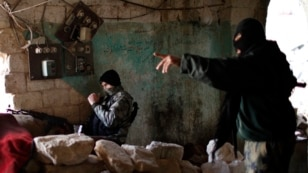 Fighters from the Islamist Syrian rebel group Jabhat al-Nusra on the front line during a clash with Syrian forces loyal to President Bashar al-Assad in Aleppo in December.