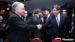 Armenia - Foreign Minister Edward Nalbandian (L) and his Turkish counterpart Ahmet Davutoglu shake hands before the start of a BSEC meeting in Yerevan, 12Dec2013.