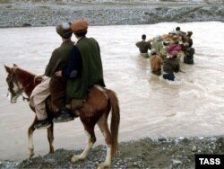 Bloody history: The bodies of five drug smugglers are returned to Afghanistan after a clash between Russian soldiers guarding Tajikistans border with Afghanistan in 2004.