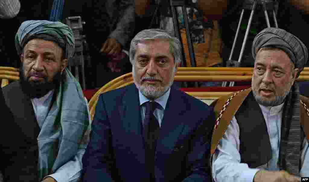 Abdullah Abdullah (center) ethnic Tajik Vice-presidential running mates: Mohammad Khan (Pashtun) (left in photo), Mohammad Mohaqeq (Hazara) (right in photo) Abdullah (born in 1960) is a former foreign minister and qualified eye surgeon. He finished second behind President Hamid Karzai in the 2009 presidential election, with around 30 percent of the vote. The Jamiat-e Islami and Hezb-e Islami were deadly rivals during Afghanistan's civil war, but that did not prevent Jamiat-e Islami member Abdullah from adding Hezb-e Islami associate Khan to his ticket.