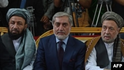 FILE Afghan Chief Executive Abdullah Abdullah (C) sits with his two deputies Mohammad Khan (left) and Mohammad Mohaqiq during a gathering in Kabul in October 2013.
