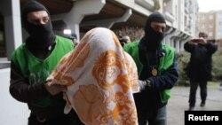 Берлиндегі теракт жасауды жоспарлады деген күдіктілерді ұстау сәті. Германия, 4 ақпан 2016 жыл.