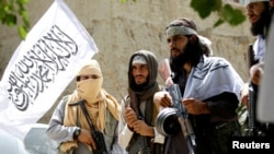 FILE: Taliban celebrate ceasefire in the eastern province of Nangarhar in June.