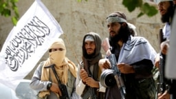 Taliban fighters celebrate a cease-fire in the Ghanikhel district of Nangarhar Province on June 16.