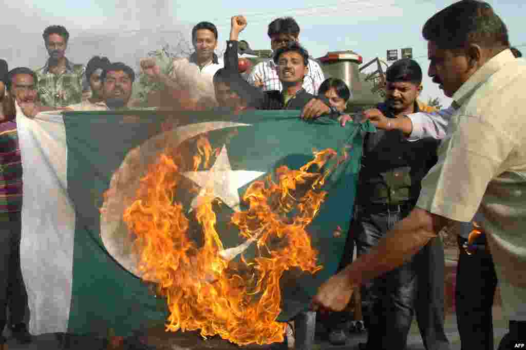 Indian activists shout slogans as they burn a Pakistani flag during a demonstration against Pakistan's imprisonment of Sarabjit Singh, an Indian prisoner held in the country. (AFP/Narinder Nanu)