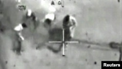 A video grab from cockpit recordings shows Iraqis being shot from a U.S. Apache helicopter on July 12, 2007. Reuters photographer Namir Noor-Eldeen also died in the incident.