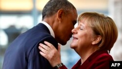 U.S. President Barack Obama is welcomed by German Chancellor Angela Merkel upon his arrival at the chancellery in Berlin on November 17.