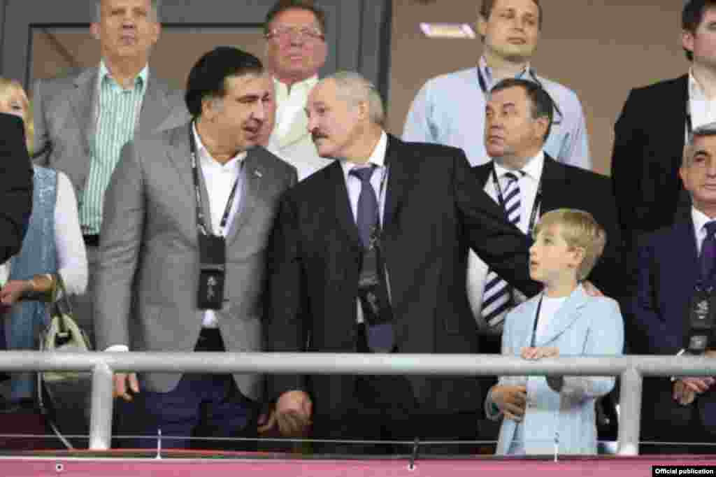Kolya and his father with then-Georgian President Mikheil Saakashvili at the Euro 2012 finals in Kyiv.