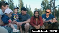 "Yakut shaman Aleksandr Gabyshev (2nd right) met hundreds of people on his journey to Moscow to ""exorcise"" Vladimir Putin."