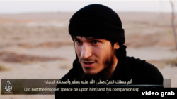 A screengrab from an IS video featuring a man, who is apparently an ethnic Russian, explaining why joined the extremist group.