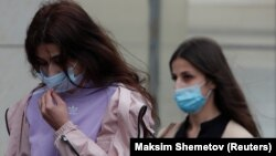 Krestina (left) and Angelina Khachaturyan, two of the three sisters accused of killing their father, arrive for a court hearing in Moscow in July.