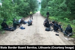 Men apprehended on a forest road near the Belarusian border on July 1.