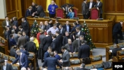 Opposition deputies block the rostrum and presidium of the parliament in Kyiv on January 14.