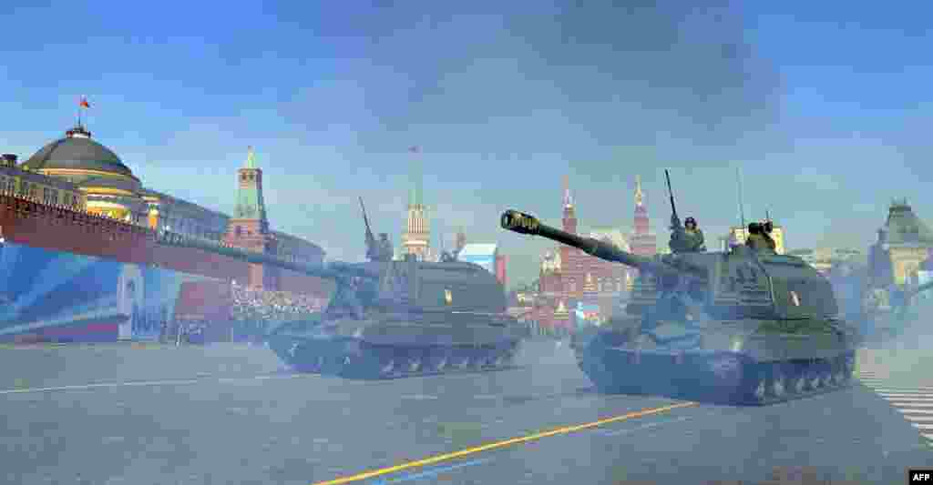 A column of Russian tanks drives through Moscow's Red Square during the Victory Day parade.