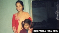 An undated photo made available by the family shows Asia Bibi, a mother of five, who was accused in 2009.