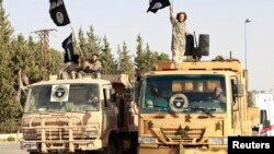 """Ислам мемлекеті"" ұйымының содырлары. Ракка, Ирак. (Көрнекі сурет)."