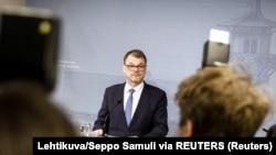 Премьер-министр Финляндии Юха Сипиля во время пресс-конференции 8 марта 2019 года