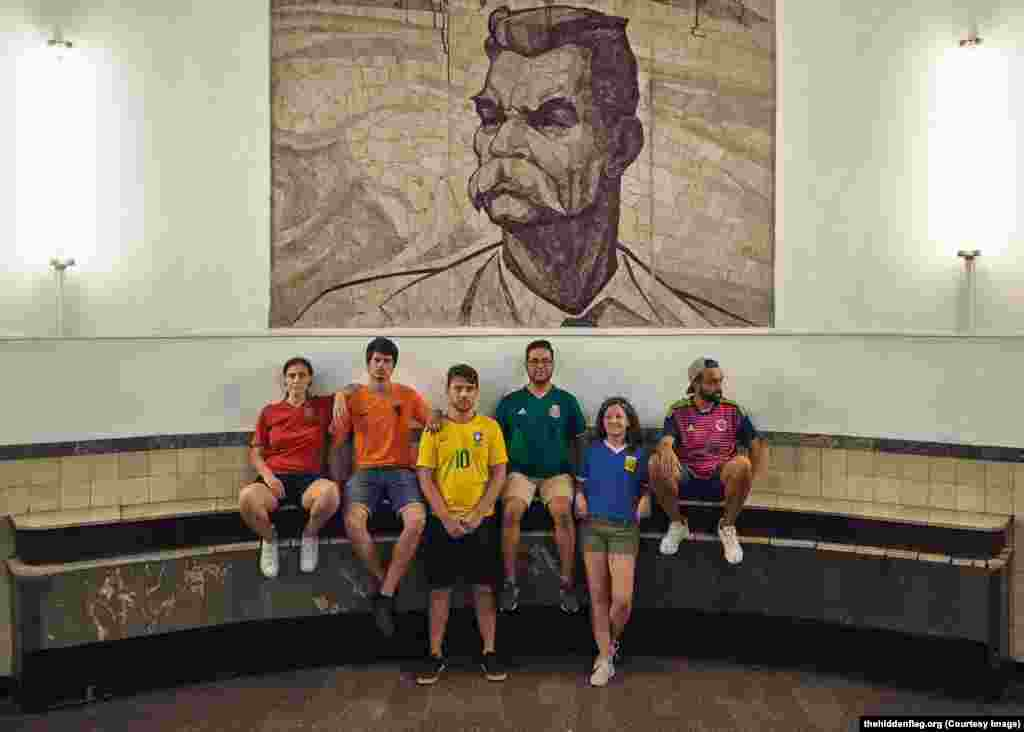 The group under a portrait of Soviet writer Maksim Gorky, in the Moscow subway.