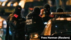Полицияның арнайы жасағы рейд кезінде. Брюссель, Бельгия, 22 қараша 2015 жыл.