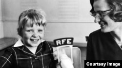 Germany--Olga Kopecka (Valeska) of RFE's Czechoslovak Service (right) and young guest Zdenka Sudova at RFE Headquarters in Munich in 1965.