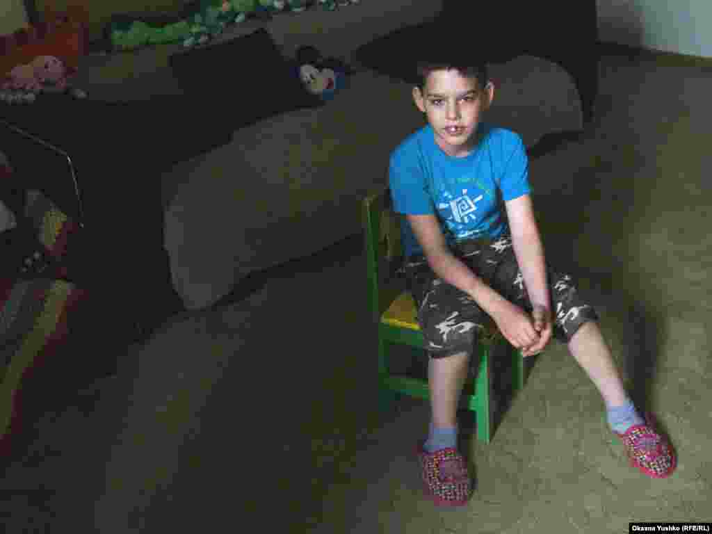 11-year-old Misha was taken into care after his father, an Azeri, was convicted of a crime and deported from Russia.