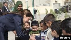 Королева Иордании Рания на одном из благотворительных мероприятий.