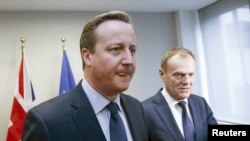 British Prime Minister David Cameron (L) and European Union President Donald Tusk meet before the EU summit in Brussels.