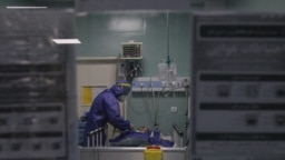A COVID-19 patient in the intensive care unit of a Tehran hospital. March 23, 2020