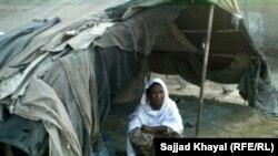 Zar Sanga sits outside her shelter in Pakistan's Khyber Pakhtunkhwa Province
