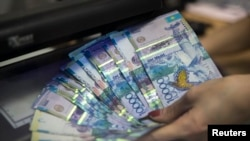 The tenge lost more than one-quarter of its value against the dollar on August 20.